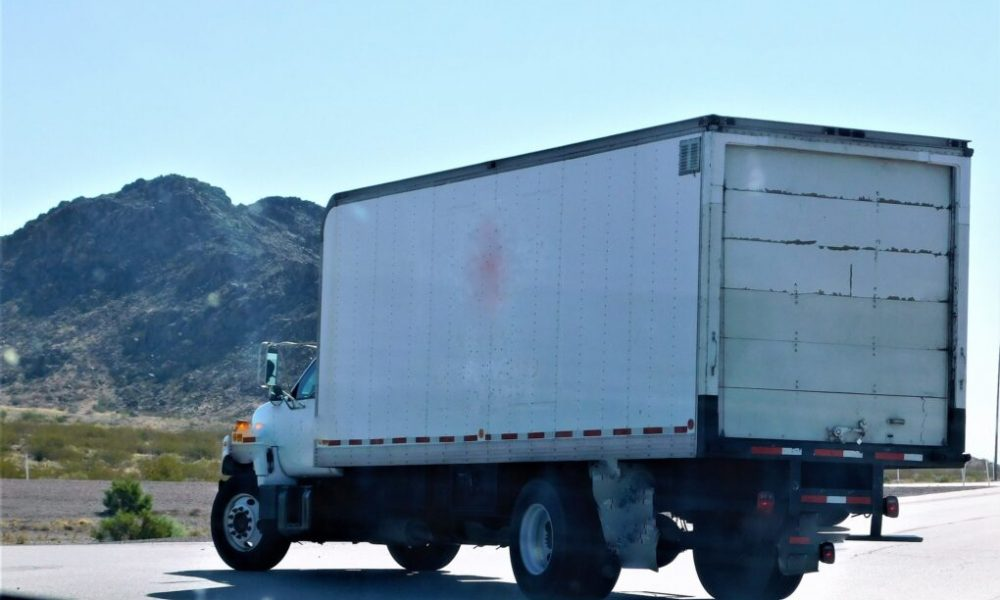 Transportation and Logistics! A big rig box truck parked in the remote landscape.